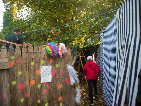 A volunteer walks through the clown area during preparations