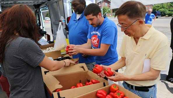 Residents explore the produce options at the Mobile
