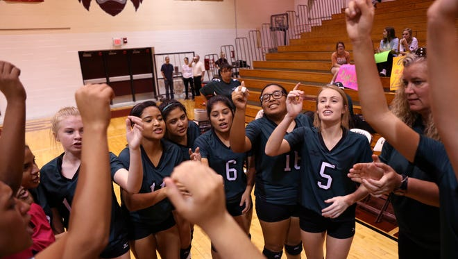 Taft Greyhound volleyball players come together before their game against the London Pirates in the regional quarterfinals on Monday, November 6, 2017. London won the match in three sets.