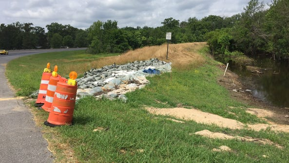 Sandbags remain at the Chauvin levee at Forsythe extension.