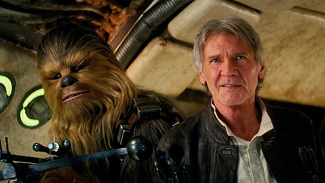 "This photo provided by Lucasfilm shows Peter Mayhew as Chewbacca and Harrison Ford as Han Solo in ""Star Wars: The Force Awakens,"" directed by J.J. Abrams. The movie opened in U.S. theaters on Dec. 18, 2015."