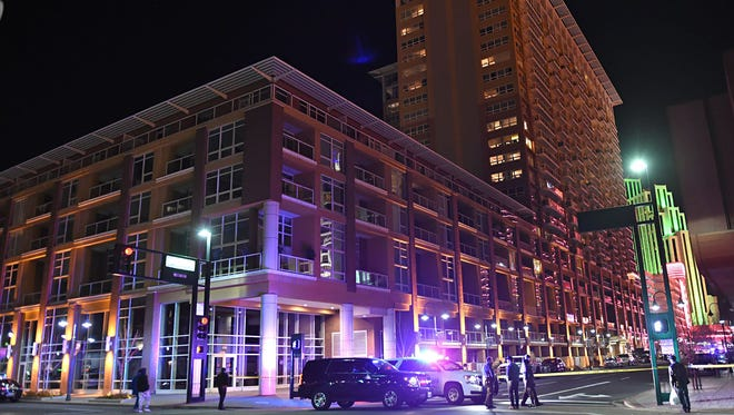 Police in Reno, Nev., close off Sierra Street downtown next to The Montage condominiums where a gunman shot at the street for about 30 minutes from an eighth-floor unit Nov. 28, 2017.