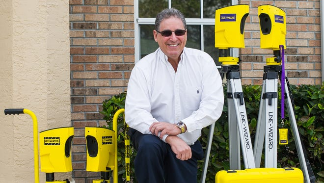 Paul Weiner, CEO of Invis-a-Beam LLC, poses for a photograph at his office in Naples, Fla., on Thursday, Feb. 23, 2017. Paul Weiner has created several products, including the Park-Daddy Garage Parking System, which was just licensed by Voxx Electronics for national distribution. Voxx Electronics is a subsidiary of Voxx International, a leader in automotive and consumer electronics and accessories with brands such as RCA and SiriusXM.