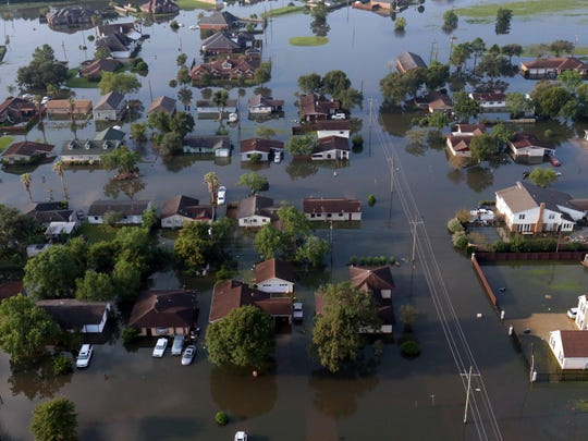 In this arial photo, homes sit in floodwaters caused