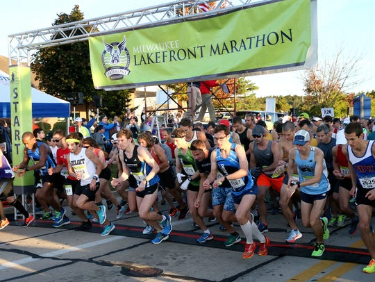 Runners cross the starting line at the sound of the