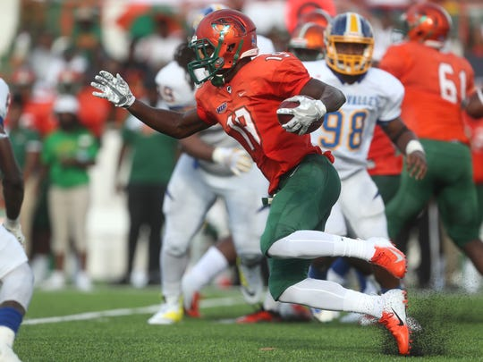 FAMU's Xavier Smith runs with the ball against Fort Valley State University as they open the season at Bragg Memorial Stadium on Saturday, Sept. 1, 2018.