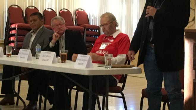 Sheriff Robert Shepperd speaks during a candidate forum Monday. Seated, left to right, are challengers Rudy Saiz, William M. Heineken, and William Butts.