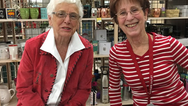 Lydia Burger, left, and Bobbie Brister just can't stand to see a sloppy store. They volunteered two years ago to spruce up Burkes for free. The store put them on the payroll. Sales are rising ever since.
