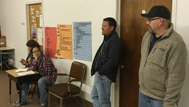County Commissioner Dallas Draper, right, and village parks and recreation director Rodney Griego helped soccer parents Wednesday as they worked to reorganize their league.