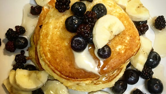 Try these coconut flour pancakes with berries and bananas