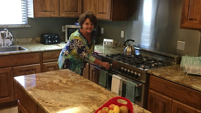 Barbara Watson, administrator of the new Good Life senior home, shows off its new kitchen.