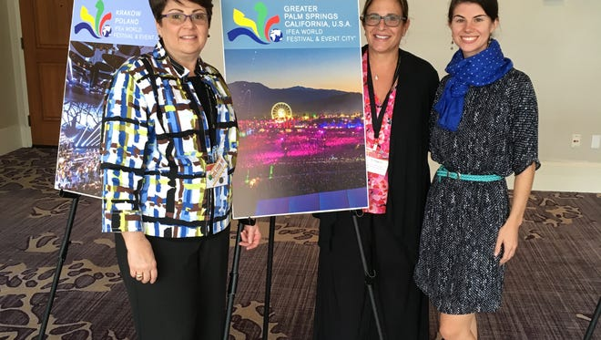 Christi Salamone, president and CEO of the California Desert Arts Council, poses with a photo showcasing events in the Greater Palm Springs with colleagues Jan Maguire and Brittany Delany at the International Festivals and Events convention in September.