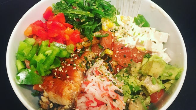 When Main Street Poke opens in Carmel in spring 2017, consider this power poke bowl with salmon, tuna, unagi (eel) and crab stick. The salad also includes tofu, corn, avocado, bell peppers, seaweed salad  and sprinkles of sesame seeds and the Japanese seasoning blend furikake. All the ingredients rest on spring mix salad.