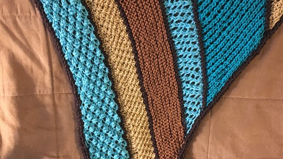 The icord edging all around the shawl gives it a nice,