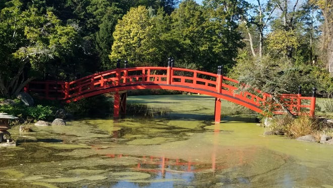 A bridge over a tranquil pond leads to the Meditation Garden in a section of Duke Farms that will be opened to the public this weekend.