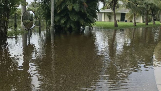Flood waters covered Salerno Road in St. Lucie Settlement during the high tide on Oct. 6.