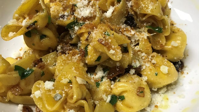Pasta purses stuffed with pears and Gorgonzola cheese alongside onions and golden raisins in brown butter sage sauce with toasted bread crumbs and parmigiano reggiano at Saly G's Restaurant and Tavern in Warren