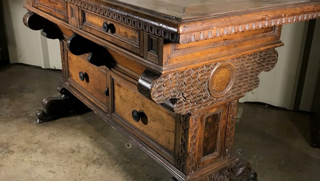 This 1900s Italian Renaissance style walnut table has been deaccessioned or permanently removed from the collection of the University of Tennessee's McClung Museum of Natural History and Culture and is being sold in an online auction.