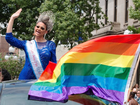 Miss Gay Iowa City waves to on-lookers during the annual