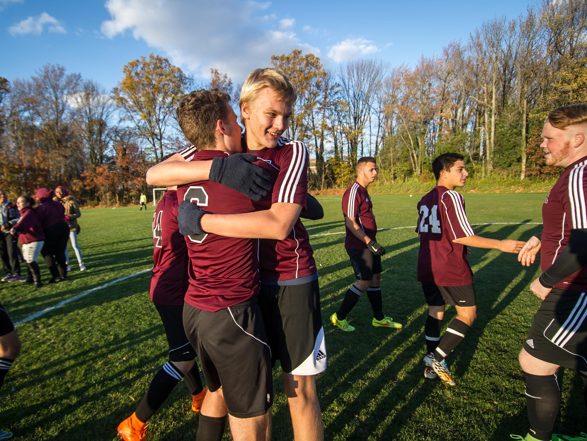 South River's Ian Sawicki (left) and Matt Pietrzyk celebrate after defeating Metuchen 2-0 in the NJSIAA Central Group I sectional final on Friday at Metuchen High School.