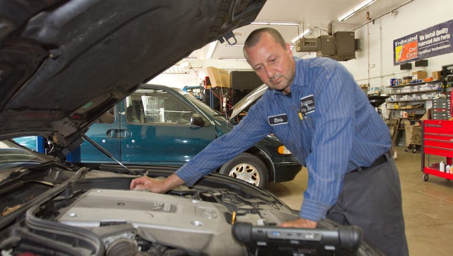 Brighton Auto Service technician Chris Donovan diagnoses an engine miss on an Infiniti G37S. Brighton Auto Service is celebrating 30 years in business.