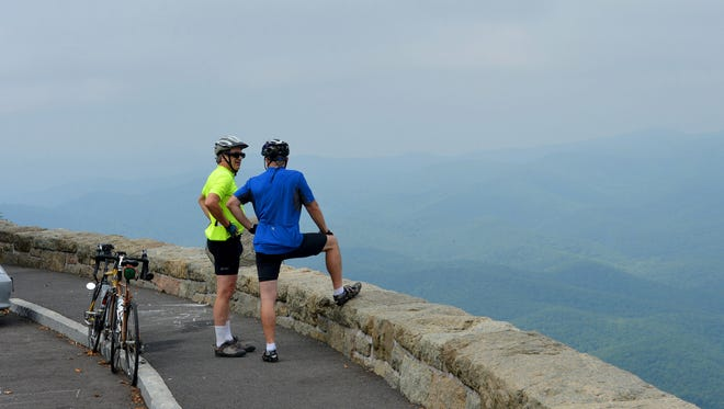 Andrew Stowe and Tim Rowe of Afton enjoy the view at Ravens Roost Overlook during a rest break from bicycling the Blue Ridge Parkway on Sunday, Sept. 7, 2014.