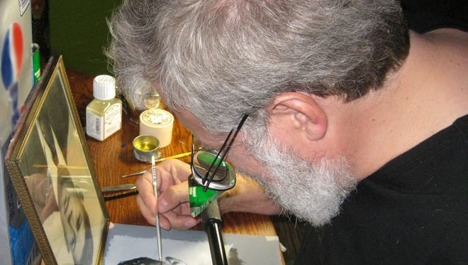 "Tim Jenison making a painting of a photograph of his father-in-law using his invention, the ìcomparator mirror,"" in 'Tim's Vermeer.'"