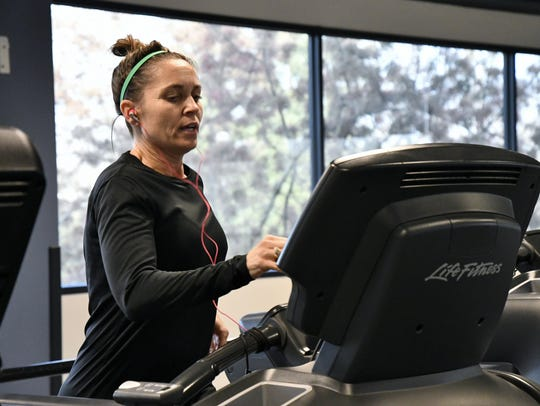 A Lifestyle Center member runs on the treadmill at
