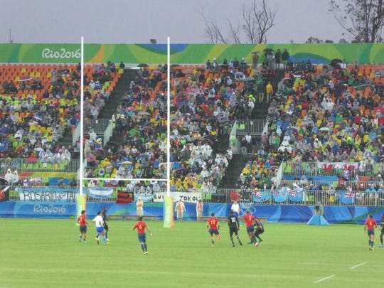 Desert chiropractor Corina Morrison shares her vantage point while watching a rainy game of rugby at the Rio Olympics on Wednesday.