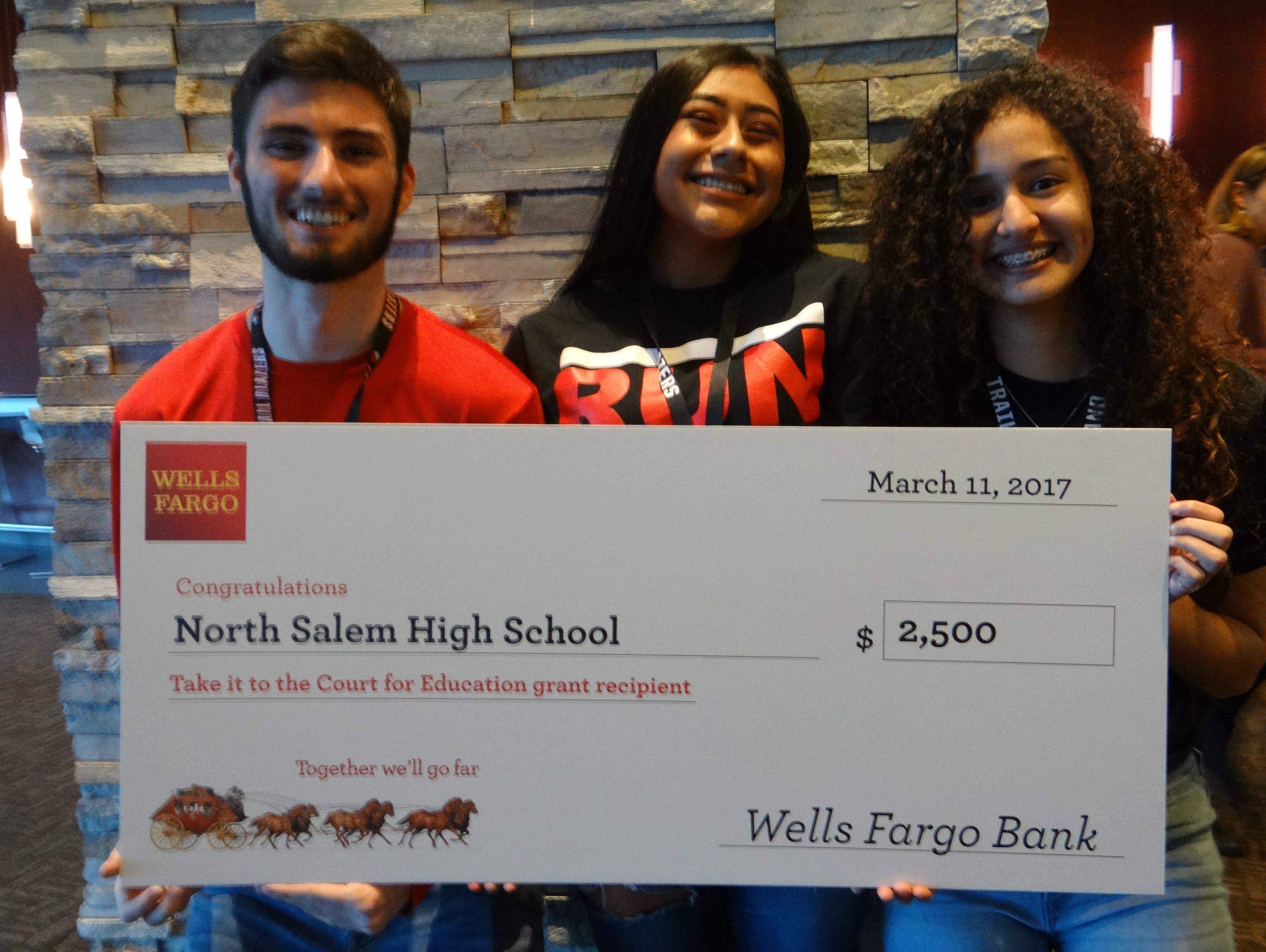 North Salem students from left, Jayden Meade, Shania Nunez and Dana Romero received a $2,500 grant from the Trail Blazers on Saturday at Moda Center.
