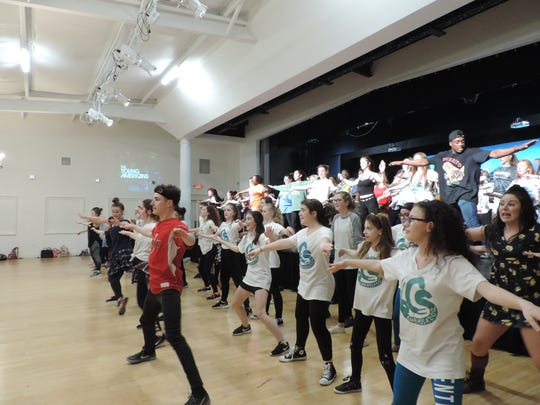 Gallatin students dance with the touring Young American