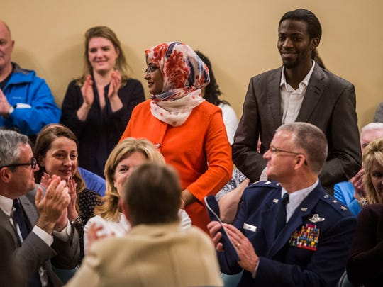 Samya Ali, center, and her husband, Salah Ali, are applauded during Mayor Miro Weinberger's State of the City address at Burlington City Hall on Monday night, April 3, 2017, after the mayor asked Burlington to welcome them. Salah, a Sudanese citizen, immigrated to the U.S. in 2014. After years of effort, Samya arrived in February but was nearly barred from entry due to President Trump's recent efforts to stop immigration from her home country.