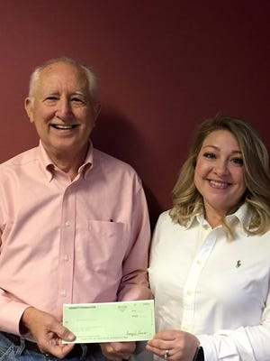 Adrianne Dunn (right), Gannett Foundation Representative, presents $2,000 to Jackie Edmonds of the Baxter County Single Parent Scholarship Fund. The grant will assist in providing scholarships to single parents in Baxter County.