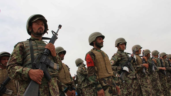 Afghan soldiers attend a graduation ceremony of Afghan