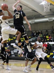 Hobbs' Nick Lopez prepares to block a shot from Alamogordo's