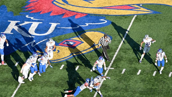 Kansas football has suspended its voluntary workouts following 12 positive COVID-19 test results, the university announced Friday. A total of 16 athletes in all Jayhawk sports have tested positive for the virus.