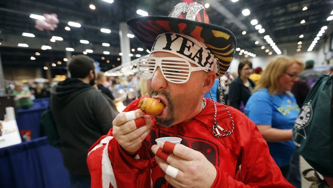 Bill McBee, of Polk City is dressed as Macho Man Randy Savage at the Blue Ribbon Bacon Fest Saturday, Jan. 31, 2015.