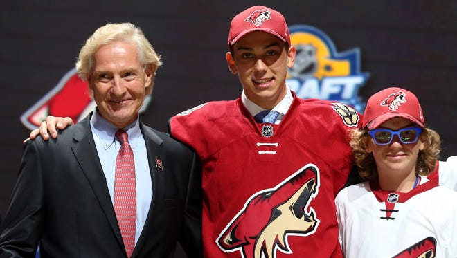 Dylan Strome poses with Coyotes GM Don Maloney after the team selected Strome third overall in the 2015 NHL Draft on June 26, 2015 in Sunrise, Florida.