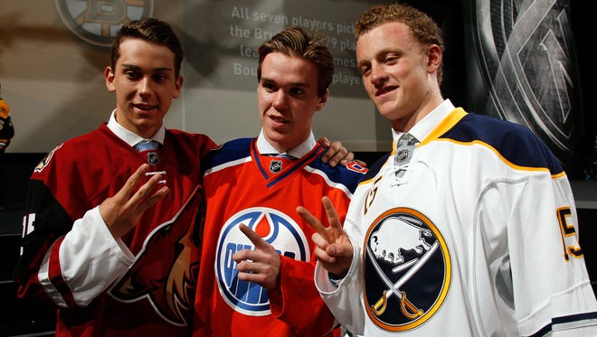 The first three picks in the draft, from left, No. 3 Dylan Strome, No. 1 Connor McDavid and No. 2 Jack Eichel.