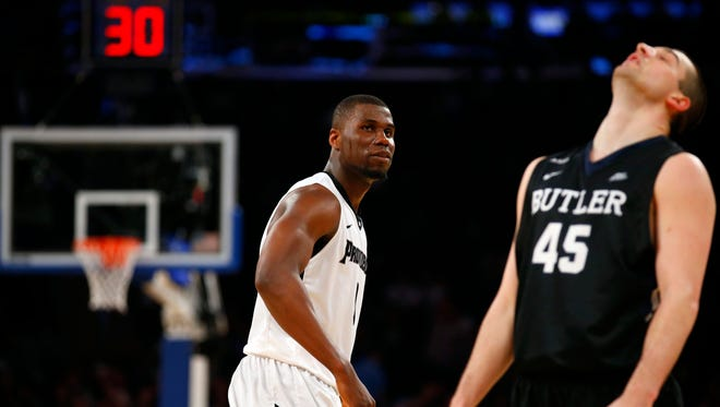Friars forward Ben Bentil (0) watches the reaction of Butler Bulldogs forward Andrew Chrabascz (45) after scoring a three point shot against him during the second half of Big East conference tournament at Madison Square Garden.