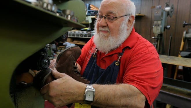 Joe Montedoro, co-owner of the Shrewsbury Cobbler Shop, repairs shoes at the shop.