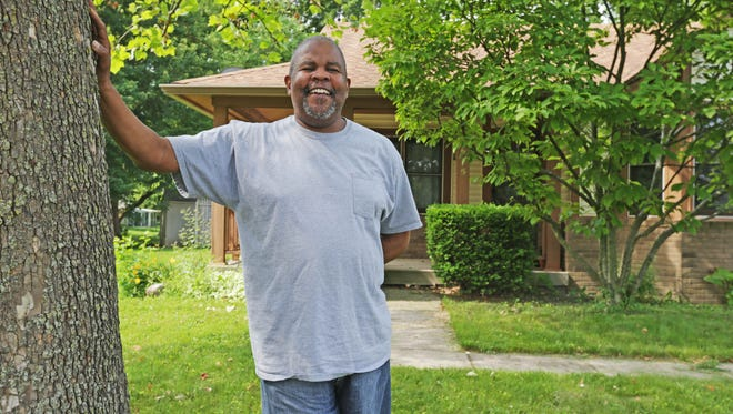 Derrick Reed stands in front of the home he hopes to close on soon, on Indianapolis' northwest side.