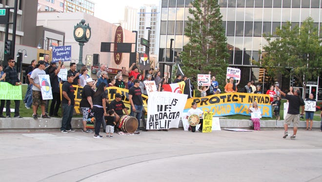 People stand in support of the Standing Rock Sioux tribe on Tuesday, Sept. 20.