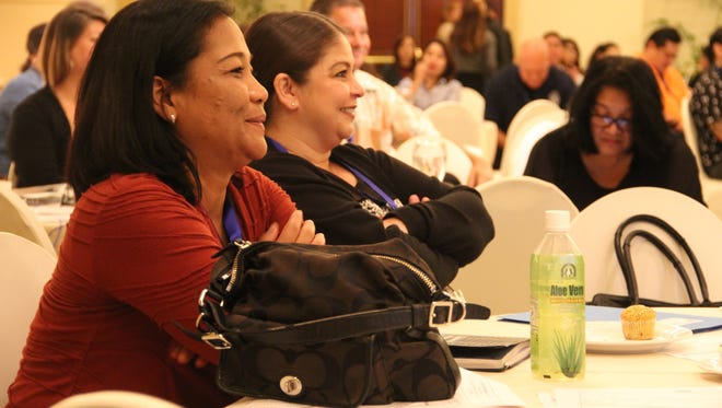 In this Nov. 18., 2016, file photo, Guam Department of Labor employees Tina Contreras and Louvana Surber listen to a presentation during an apprenticeship industry forum.