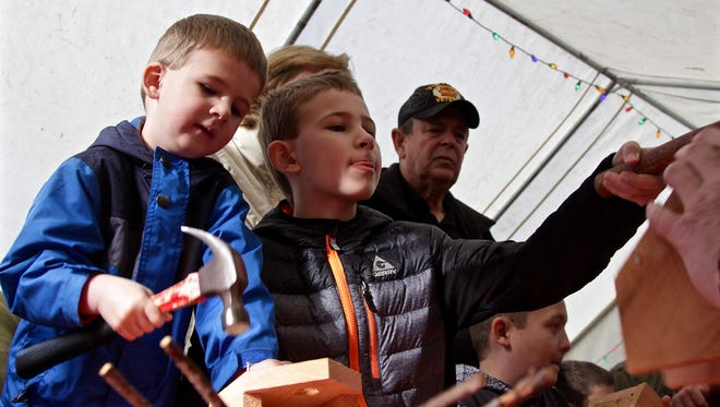 Brothers Ryan Dieterle, 4, and Logan, 8, each hammer nails into their homemade bird houses at the 39th Annual Silver Falls State Park Christmas Festival on Saturday, Dec. 10.