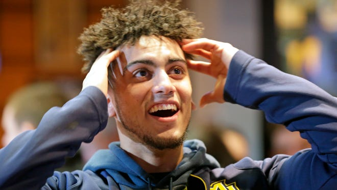 Marquette Golden Eagles guard Markus Howard reacts to Marquette's NCAA Tournament bid Sunday. Howard is the leading three-point shooter in the country.