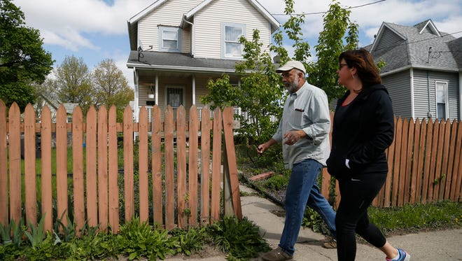 Bob Baskerville with the River Bend Neighborhood Association takes a walk with Readers' Watchdog reporter Lee Rood Thursday, April 27, 2017, in Des Moines.
