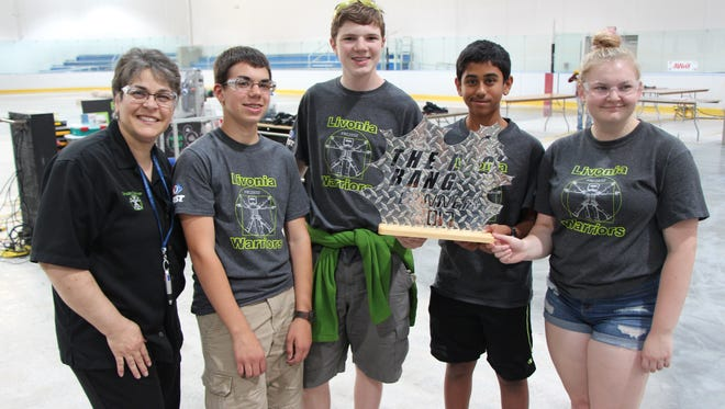 From right, Josie Stanley, Vansh Amin, Michael Snider and Gryffon Parks, rookie players on the Livonia Warriors robotics team, celebrate their alliance's win with coach Isolina Carlini following the Big Bang tournament in Taylor on July 8.