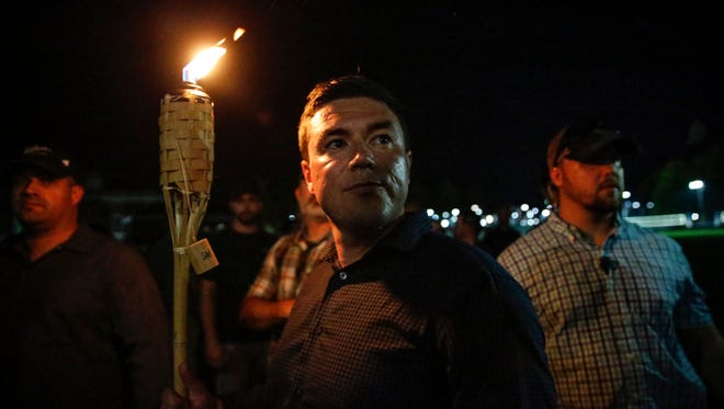 """""""Unite the Right"""" rally organizer Jason Kessler prepares to lead multiple white nationalist groups on a torch-lit march through the University of Virginia campus in Charlottesville on Friday, August 11, 2017."""