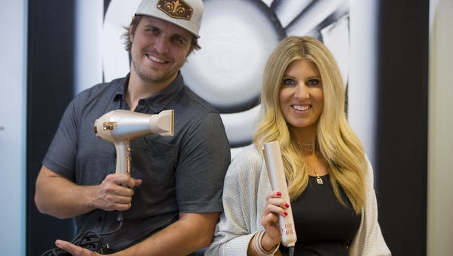 Kendrick Reeg, Tyme president of sales, and his sister, Jacynda Smith, owner of Tyme hairstyling products, show off the BlowTyme blowdryer, left, and Tyme Pro at Luxxi Salon in Phoenix on Oct. 6, 2017.